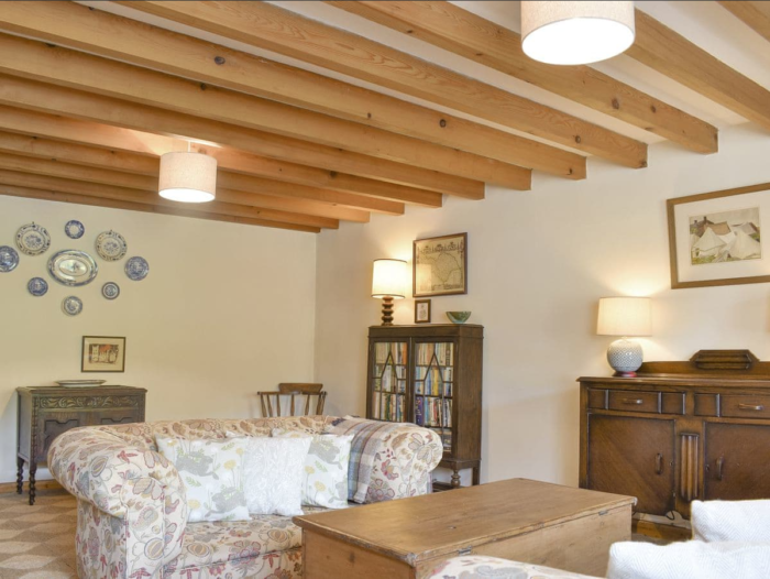 Exposed wooden beams throughout the ground floor
